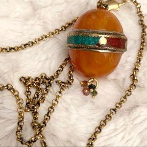 Amber Egg a pendant Necklace